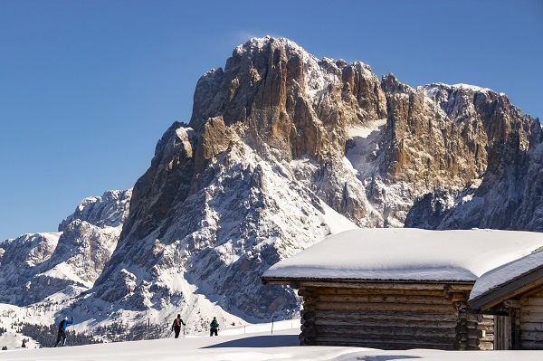 backcountry hut and skiers