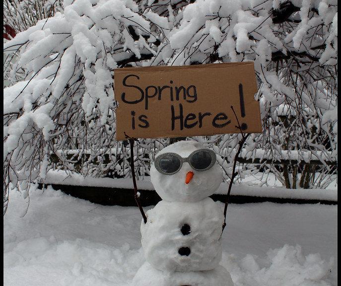 spring snowman skiing
